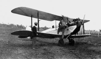 StateLibQld_2_190875_Boarding_an_early_Qantas_aeroplane,_1920-1930