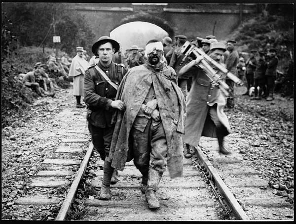 Boche prisoner, wounded and muddy, coming in on the 13th